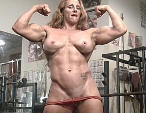Ironfire has an amazing body, and she certainly gets a lot of joy from showing it off. Whether she's getting attention for her powerful biceps or her pretty face, her strong quads or her sexy pussy - she takes it all in and gives it back! Aren't we lucky?