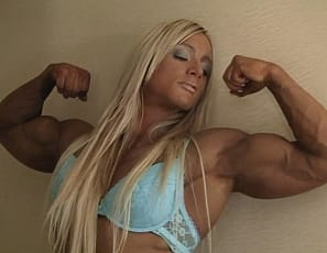 Professional female bodybuilder Katka Kyptova poses in the bedroom in panties to show you her vascular legs, calves and biceps, her ripped abs and pecs, and her muscle control of her glutes. See all that female muscle in close-up.