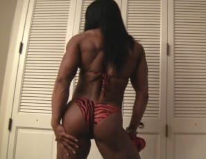 poses in sexy red panties to show you her vascular, ripped biceps