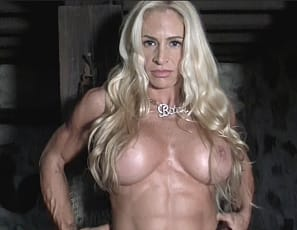 Professional female bodybuilder Jill Jaxen poses for you in a dungeon