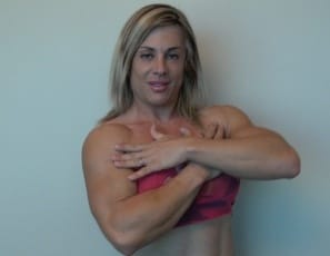 posing in sexy panties to show you her powerful pecs, vascular biceps