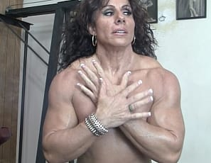 Professional female bodybuilder Annie Rivieccio is pumping iron in the SheMuscle gym, and liking how it makes her ripped pecs, abs, legs and vascular biceps feel as she poses. Watch her show off her muscle control in close-up.
