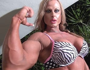 showing off her vascular biceps, ripped abs, powerful pecs