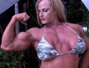 Your virtual session with ripped, tattoo female bodybuilder Nuriye has begun in the jungle, as she poses for you, showing you her muscle control of her powerful pecs, and her vascular biceps, her muscular legs and glutes and tight abs. Are you ready to play jungle games?
