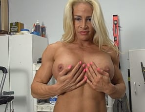 Female bodybuilder Jill Jaxen is posing nude in a workshop. She's more powerful than power tools, more ripped than a ripsaw, and has vascular biceps, and muscular, tattooed glutes, legs, and pecs. Those muscles can fix anything. See them close up.
