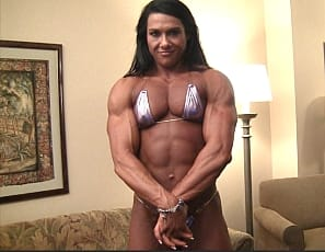When female bodybuilder Alina Popa poses you'll want to look at all of her, from her perfect pecs and gigantic biceps to her super-ripped abs to her muscular glutes, rock-hard calves and sexy shoes. But you'll want to pay special attention to her massive thighs. Can you imagine them squeezing you? We'll bet you can. We'll bet you have!