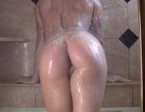 Female bodybuilder Jenna is enjoying her time naked in the shower