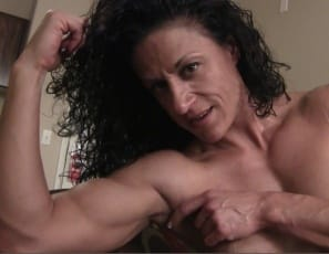 Female bodybuilder Miss Lisa is peeling off her panties until she's naked. Then she's posing and showing you the difference between flexed and unflexed biceps muscles, as well as her muscular legs, glutes and abs.
