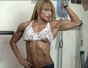 professional female bodybuilder Karina does barbell rows